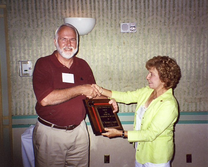 Norm Leppla receiving Entomologist of the Year award from Geri Cashion