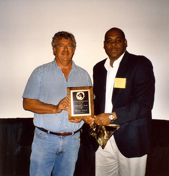 TimGast receiving 2008 Annual Achievement Award in Industry from Oscar Liburd