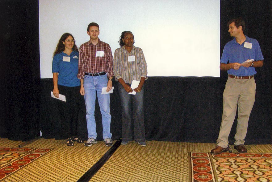 Elena Rhodes (3rd), Craig Roubos (2nd, Teresia Nyoike (1st) place awards in phd student competition