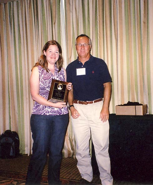 Jennifer Gillet receives Certificate of Appreciation for Special Service from Scott Ferguson