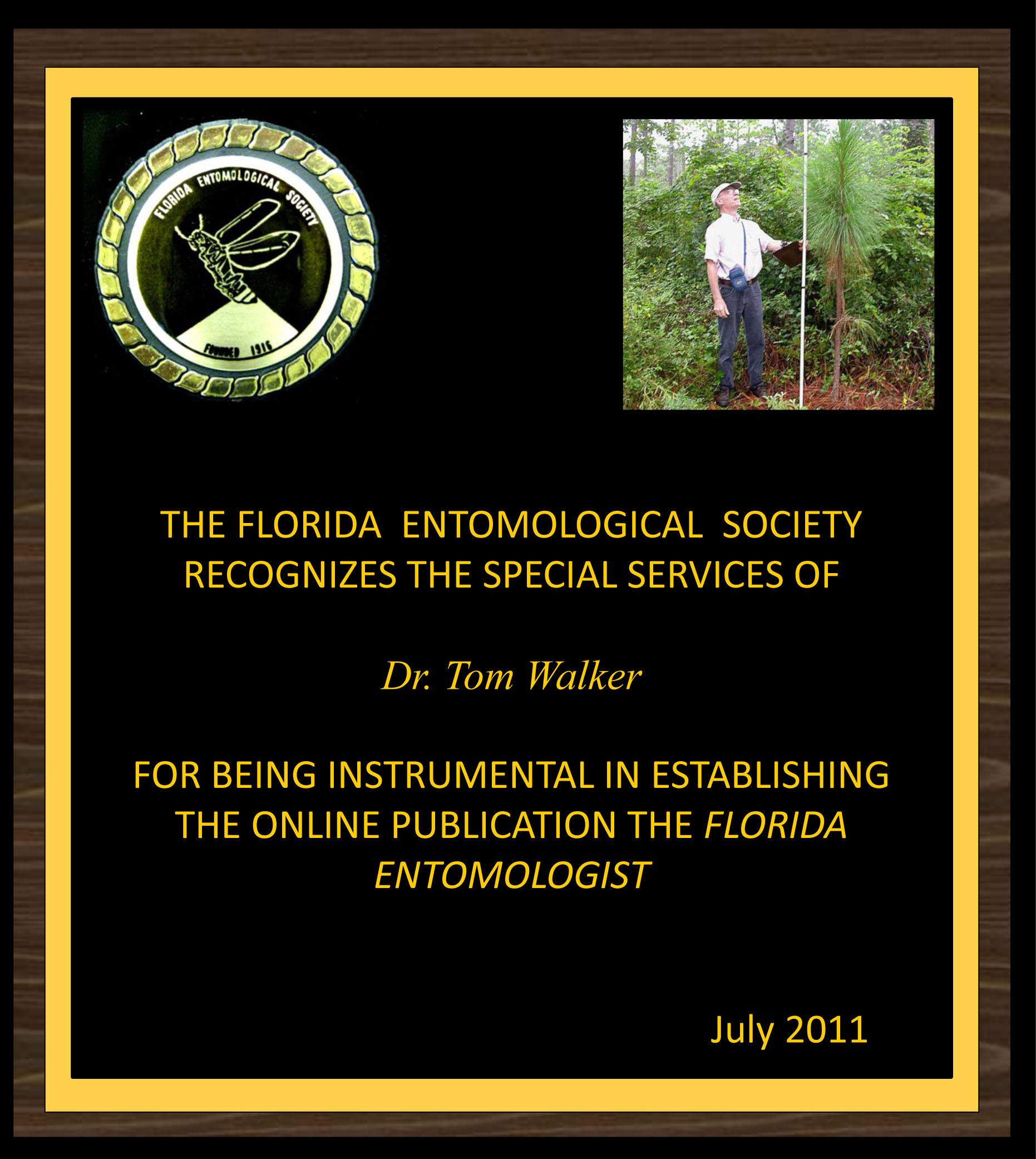 Tom Walker receives award for longtime service as Florida Entomologist Webmaster