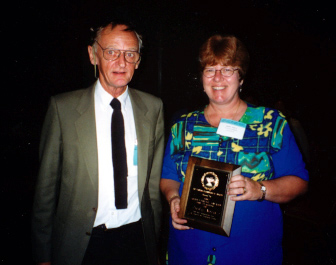 Judy Nova receives the Annual Achievement Award for Teaching from Howard Frank