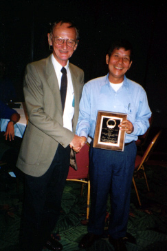 Ru Nguyen receives the Annual Award for Research from Howard Frank