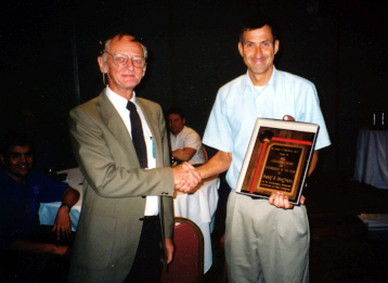 Rudi Scheffrahn wins the Entomologist of the Year Award from Howard Frank