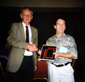 Jeffrey Shapiro receives a Presidential Recognition Award from Howard Frank
