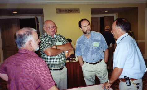 Gary Leibee, Clay McCoy, Russ Mizell, and Phil Stansly in a discussion