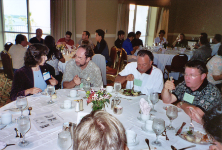 Julietta Brambilla, Russ Mizell, Phil Stansly, and Robert Meagher at table during awards luncheon
