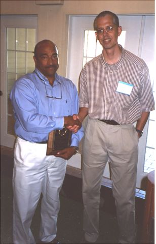 Jorge Pena receiving Annual Achievement Award for Research from Ken Bloem