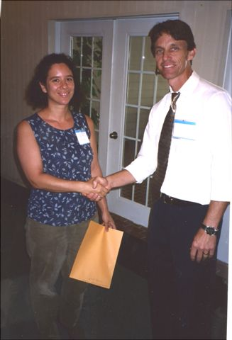Laura Sirot receives the first place prize in the student presentation from Gregg Nuessly