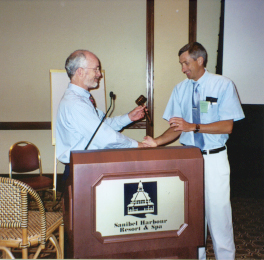 Steve Lapointe hands gavel over to incoming President, Rudi Scheffrahn