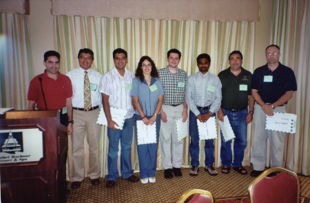 Student winners of FES 2005 $100 minigrants: (left to right) Ricky Vasquez, with Student Activities chair, Marco Toapanta, Amit Senthi, Karla Addesso, Joseph Smith, Murugesan Rangasamy,Rui Pereira, and James Dunford