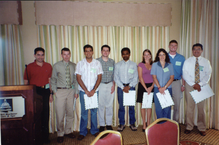 Student winners of FES 2005 $100 travel grants: (left to right) Ricky Vasquez, Charles Stuhl, Amit Senthi,  Joseph Smith, Murugesan Rangasamy,Crystal Kelts, Karla Addesso, and Frank Wessels with student Activities Committee Chair, Marco Toapanta